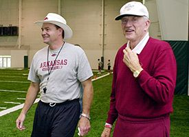 Houston Nutt, left, and Frank Broyles