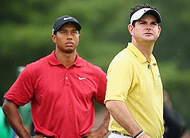 Rory Sabbatini (R), and Tiger Woods