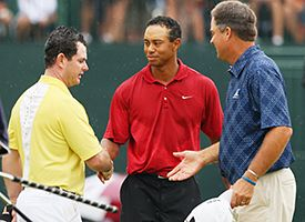 Tiger Woods (C), Rory Sabbatini of South Africa (L) and Kenny Perry