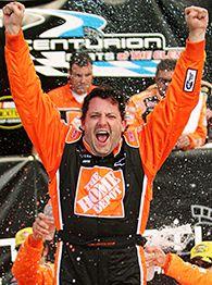 Tony Stewart celebrates his fourth career win at Watkins Glen.