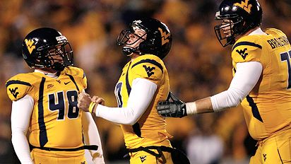 MORGANTOWN, WV - DECEMBER 1: Kicker Pat McAfee #40 of the West Virginia Mountaineers reacts after missing his second field during the first half against the Pittsburgh Panthers at Milan Puskar Stadium December 1, 2007 in Morgantown, West Virginia.