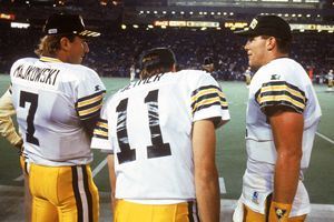 Quarterbacks Don Majkowski #7, Ty Detmer #11 and Brett Favre #4