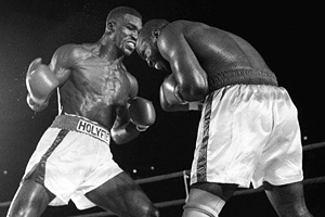 Evander Holyfield and Dwight Muhammad Qawi