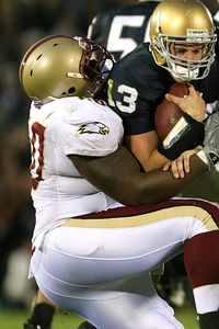 SOUTH BEND, IN - OCTOBER 13: Evan Sharpley #13 of the Notre Dame Fighting Irish is sacked by Ron Brace #60 of the Boston College Eagles on October 13, 2007 at Notre Dame Stadium in South Bend, Indiana. Boston College defeated Notre Dame 27-14. (Photo by Jonathan Daniel/Getty Images)