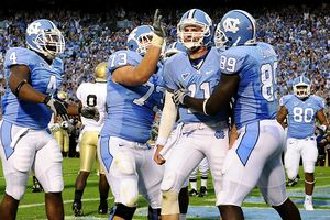 Oct 11, 2008; Chapel Hill, NC, USA; North Carolina Tar Heels quarterback Cameron Sexton (11) scores the winning touchdown in the fourth quarter and celebrates with Bobby Rome (4) and Aaron Stahl (73) and Richard Quinn (89). The Tar Heels defeated the Notre Dame Fighting Irish 29--24 at Kenan Stadium.