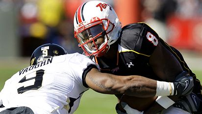 Wake Forest's Chip Vaughn (9) tackles Maryland's Darrius Heyward-Bey (8) during the first half of an NCAA college football game, Saturday, Oct. 18, 2008, in College Park, Md