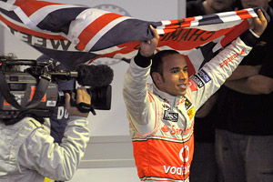 Lewis Hamilton claimed the Formula One championship by a point Sunday, one year after finishing second -- by a point.