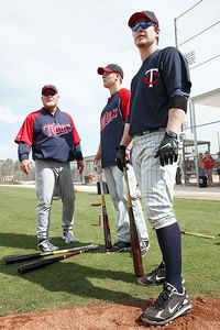 Ron Gardenhire, left, and Justin Morneau, center