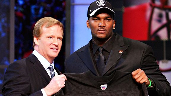 NEW YORK - APRIL 28: Quarterback JaMarcus Russell of Louisiana State University poses for a photo with NFL Commisioner Roger Goodell after being drafted first overall by the Oakland Raiders during the 2007 NFL Draft on April 28, 2007 at Radio City Music Hall in New York City.