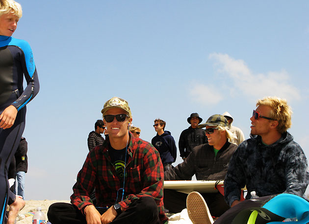 This is what you call local flavor. The brothers Gudauskas and Kolohe Andino jive talkin' on the beach at their home away from home.
