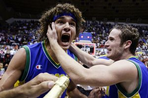 Brazils Anderson Varejao, left, celebrates with teammate Marcelo Huertas after defeating Puerto Rico 61-60.  (AP Photo/Andres Leighton)