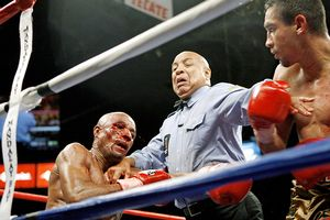 Francisco Lorenzo, left, trades punches with Humberto Soto as ref Joe Cortez steps between them
