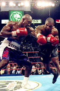 Evander Holyfield (L) and Mike Tyson