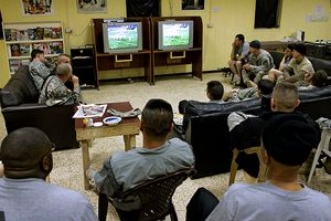 Soldiers watching football