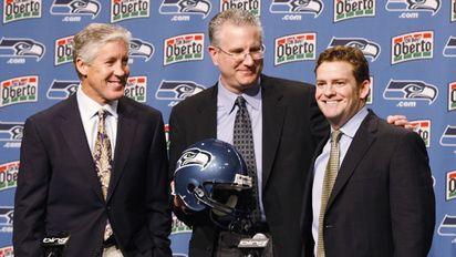Pete Carroll, Tod Leiweke, John Schneider