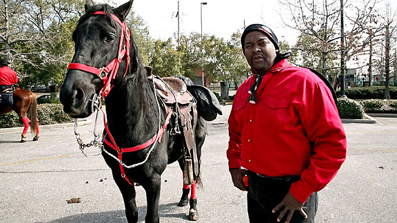 Man with horse in red... Super Bowl Sunday 2010 New Orleans, LA