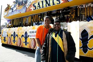 Saints fans pose by a float in New Orleans, LA- Super Bowl Sunday 2010
