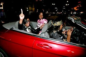 Saints fans cheer as they drive through New Orleans, LA after Super Bowl XLIV