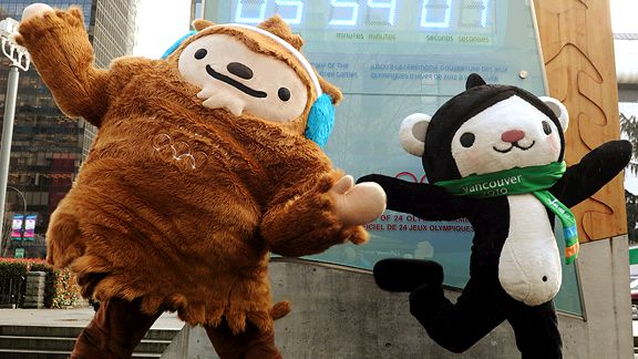 Winter Olympic mascots Miga (R) and Quatchi