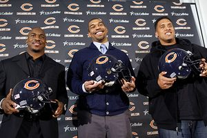 Chester Taylor, Julius Peppers, and Brandon Manumaleuna