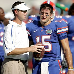Quarterback coach Scot Loeffler and Tim Tebow