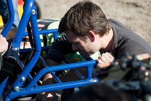 Jeff Gordon inspecting a go-kart