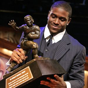 Reggie Bush with Heisman Trophy