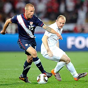 Jay DeMerit and Wayne Rooney
