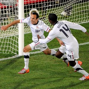 Landon Donovan (10) celebrates his goal with forward Edson Buddle