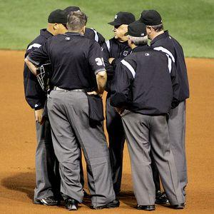 Umpires huddle to make a ruling