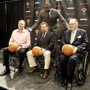New York Knicks' Amare Stoudemire with head coach Mike D'Antoni, team owner James Dolan, and president of basketball operations Donnie Walsh