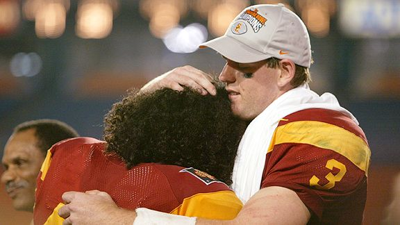 Carson Palmer of USC hugs teammate Troy Polamalu