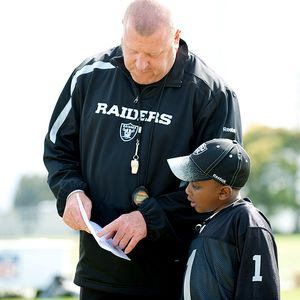 Jailen with Raiders coach Tom Cable