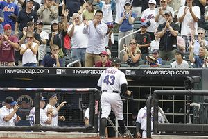 Mets fans applaud R.A. Dickey.
