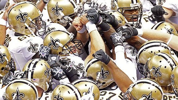 New Orleans Saints huddle around Drew Brees