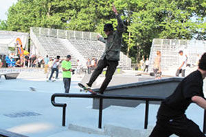 The Gonz doing what he does. Fronside boardslide at the Maloof NYC contest, wearing an army jacket in 95 degree heat.
