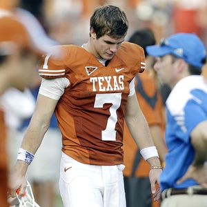 AP Photo/Eric Gay Garrett Gilbert and the Longhorns managed only one ...