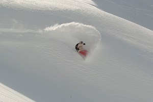 Nyvelt hacking a double-overhead white wave somewhere in AK.