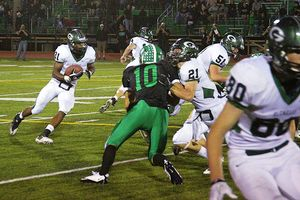 Glenbard West running back Kendall Johnson carries the ball