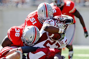 Ohio State's Ross Homan, (51), Brian Rolle (36)