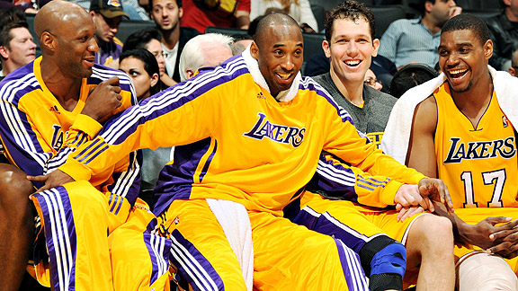 Caption this: Kobe Bryant and his teammates react from the bench