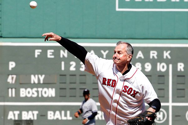 UConn coach Jim Calhoun threw out the first pitch at Fenway Park on Saturday. He said he will wait to decide if he will return to coaching or retire.