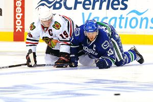 Jonathan Toews and Henrik Sedin