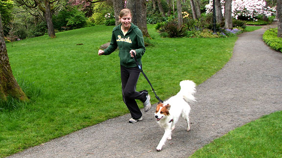 Catherine Ryan running with dog