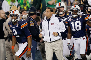 Cam Newton and Gene Chizik