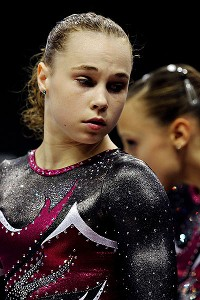 Defending all-around champion Rebecca Bross dislocated her kneecap on the vault