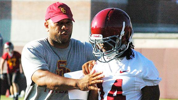 Sammy Knight works with Isiah Wiley