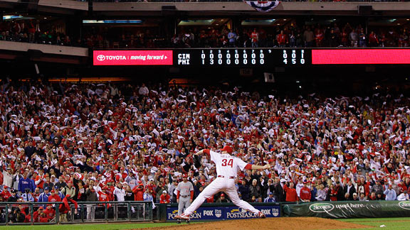 Only a fifth-inning walk to Jay Bruce kept Roy Halladay from throwing a perfect game.
