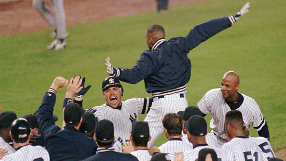 Jim Leyritz is mobbed by his teammates after his walk-off home run gave the Yankees a 2-0 series lead.