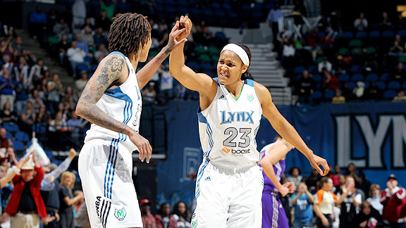Lynx top scorer Seimone Augustus gets a high-five from rookie Maya Moore. Augustus netted 21 points in Minnesota's Game 1 Western Conference finals victory over the Phoenix Mercury.